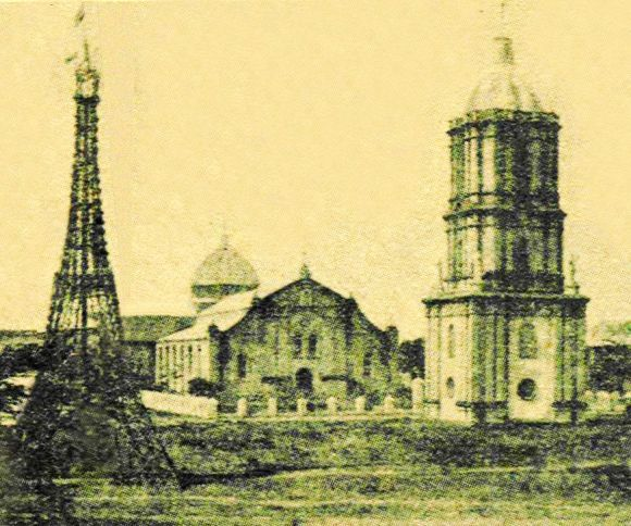 This photo reportedly taken in about 1889 shows the Jaro Cathedral and belfry with a bamboo replica of the Eiffel Tower, the icon of modernity in its times. Note the absence of the two church towers that were added much later.