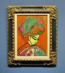 girl in flowered hat