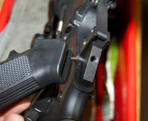 Removing the standard AR-15 grip and selector spring