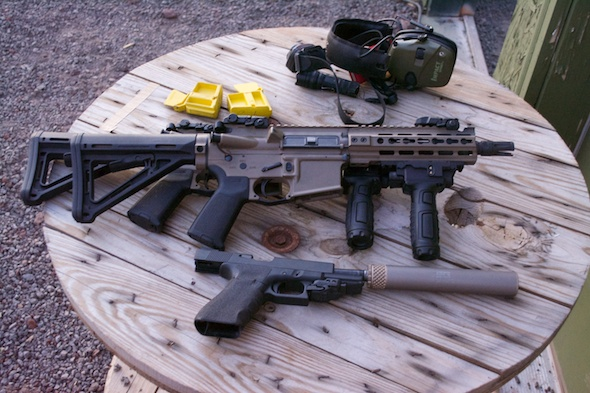 A Primary Weapons System Diablo and an AAC suppressed Glock - some of the required gear for a house clearing stage.