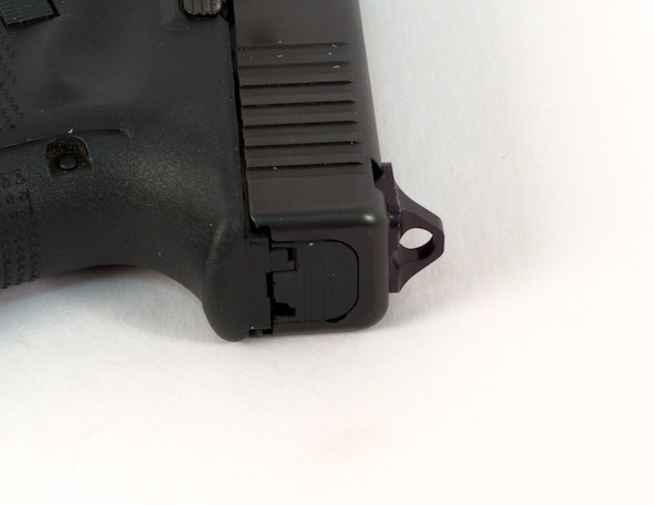 The rear sight unit is slightly higher than a standard Glock sight.