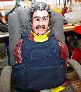 Is he a plastic Saddam Hussein or a 1970s Porn Star? We don't know, but either way he's protected with Engarde Body Armor.