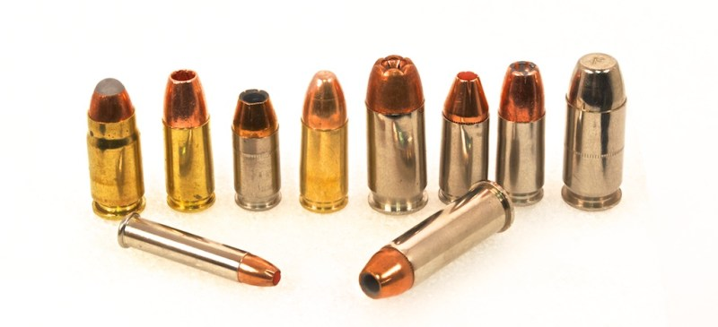 Good self-defense ammunition comes in all shapes and sizes. The fourth round standing from the left is a 9mm full metal jacket practice round. The one on the far right is a Federal Guard Dog expanding full metal jacket round.