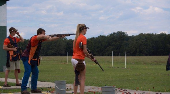 Trap Shooting: Competitors fire at targets moving away from the shooting line.