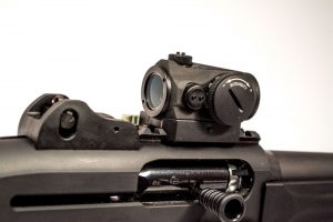 The Aimpoint Micro H1 optic fit perfectly and allowed for co-witness of the ghost ring sights.