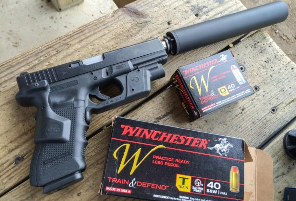 We tested the .40 S&W Winchester Train and Defend in several different guns including this suppressed Glock.
