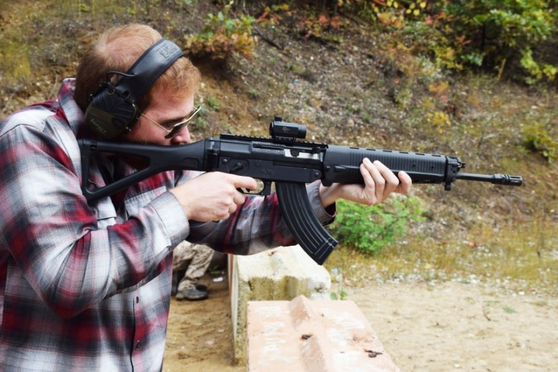 A shooter aims the Sig 556R. The 556R is chambered in 7.62x39mm and utilizes standard AK-pattern magazines. Image by Matt Korovesis.