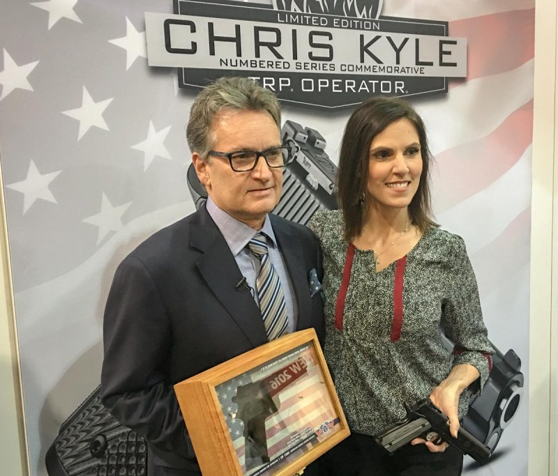 Springfield Armory CEO Dennis Reese presents the Chris Kyle TRP Operator pistol to Taya Kyle.