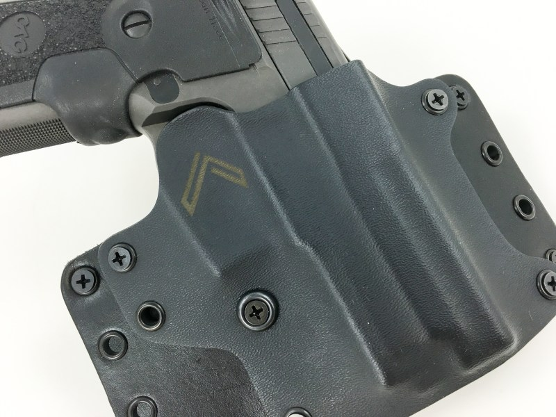 This Blackpoint outside-the-waistband holster is built like a tank and uses both leather and Kydex components. Note the screw nearest the center – that's for adjusting the tension on your gun. Loosen it for an easier draw or tighten for more gun retention.