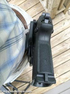 The soft belt loop attachment allowed the gun to pull away from the body and flop around while moving.