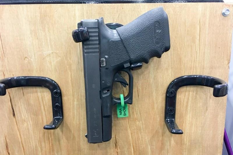 Simplistic but clever. Vertical Gun Racks makes supports for handguns and long guns.