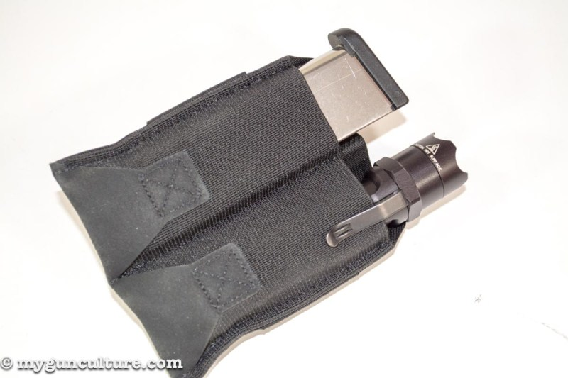 I've been using the double magazine pouch to carry one spare magazine plus a flashlight. Handy.