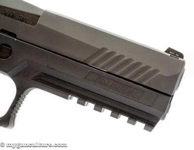If you're into press checks, the Sig P320 has forward cocking serrations.