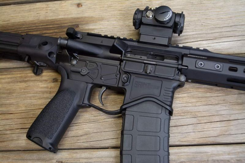 The spiffy cuts on the lower receiver not only look good, they shave some ounces.
