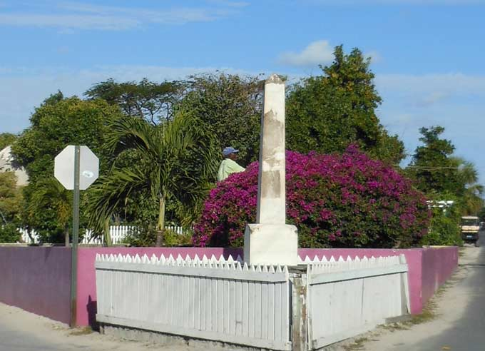 Center of town -- monument to the island's first doctor, with a new fountain behind it.