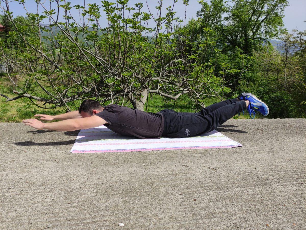 Superman exercise ending position