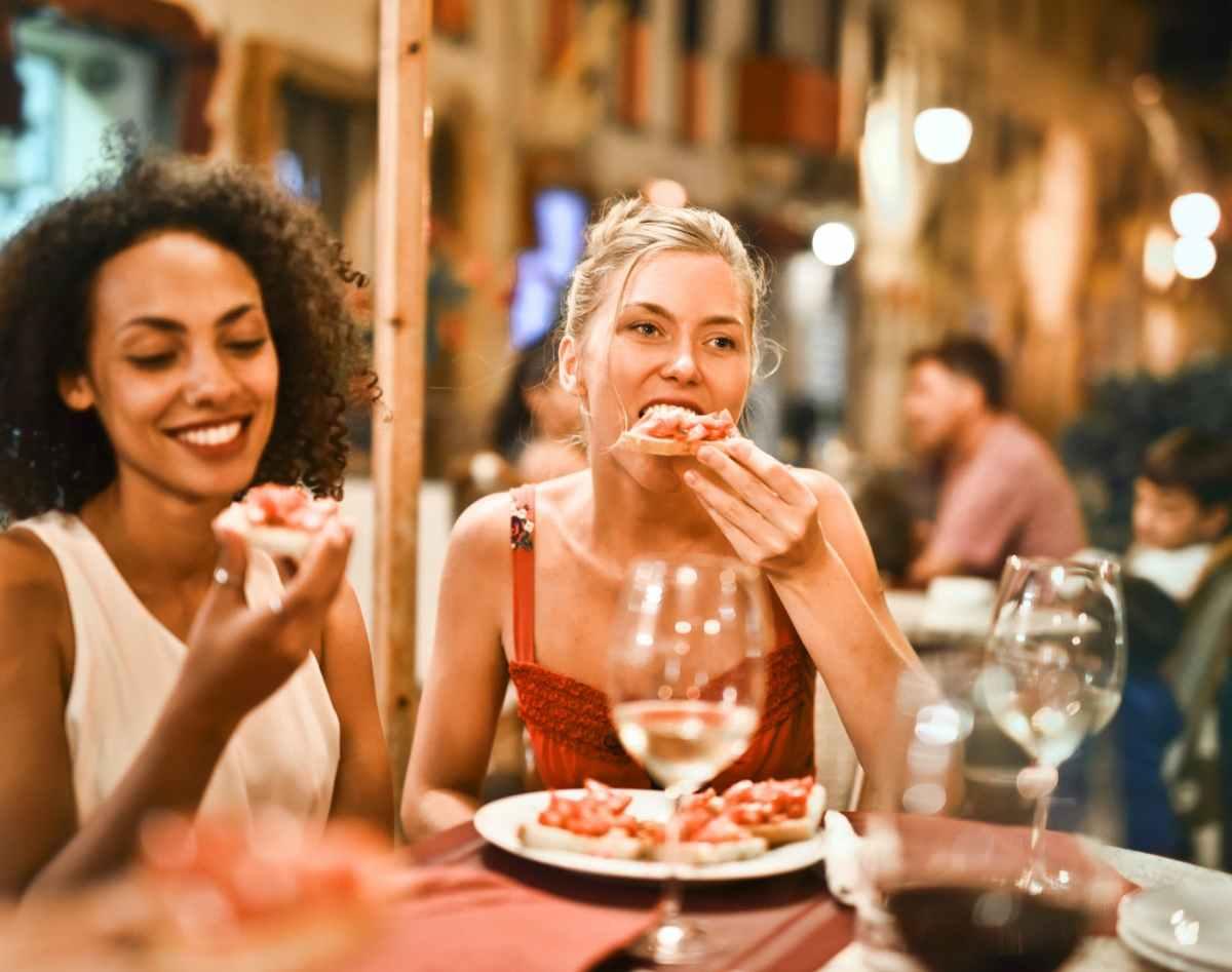 woman eating bruschetta