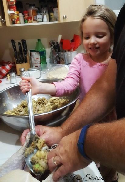 18-helping-grandpa-stuff-the-turkey