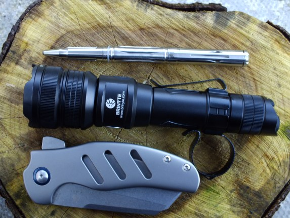 A photo of the NTP20 with the Kizer Sheepdog and Brinyte PT18 Oathkeeper