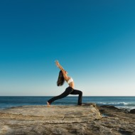 woman-warrior-pose-beach