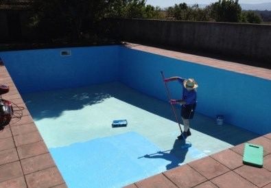 Dad painting the floor of the swimming pool