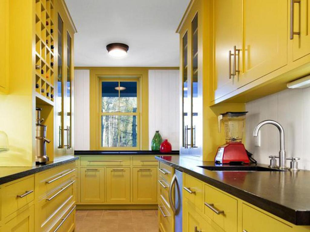 Yellow cabinets and yellow window in kitchen