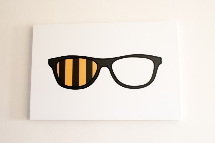 Hipster glasses make one eyed fans look hip with this Fanfare print