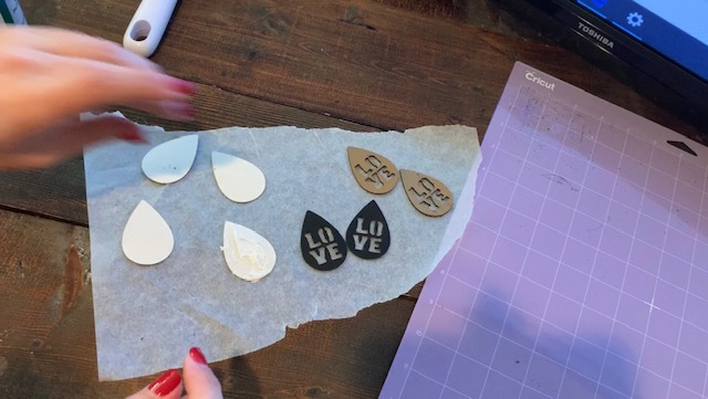 Glue two glitter faux leather earring pieces together to make Valentine's Earrings diy