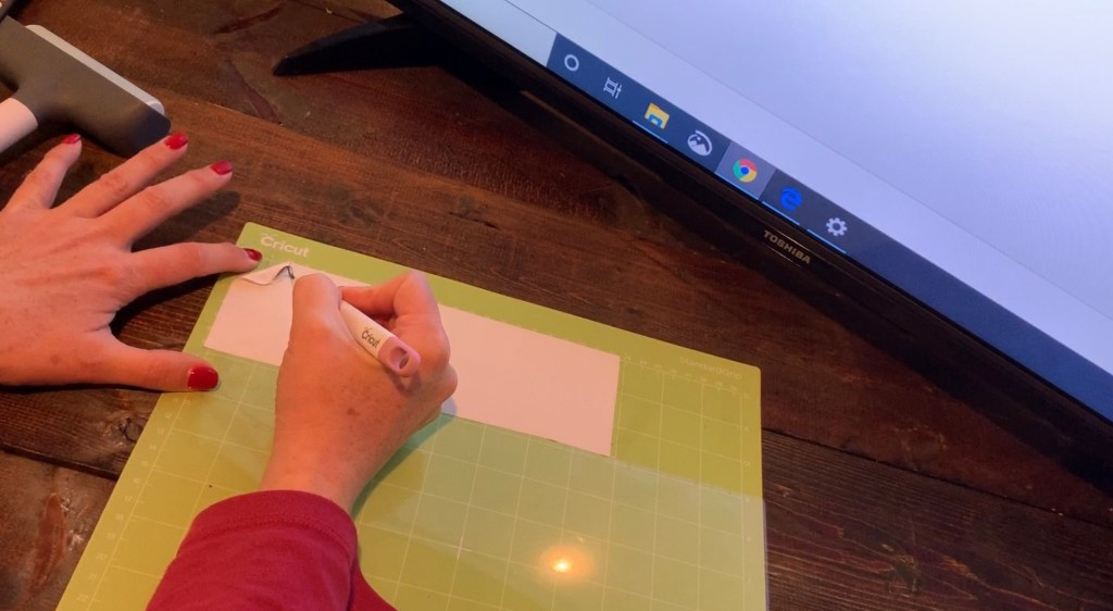 Cricut transfer paper on a Cricut mat before putting the glitter faux leather on the mat, to help it from making a mess on the mat