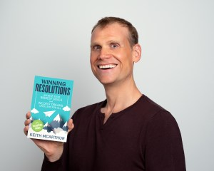 Keith holding Winning Resolutions