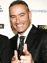 Invisalign complaince - picture of Anthony wiggle with over-White teeth