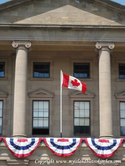 The Canada Flag flies at Province House in Charlottetown, PEI