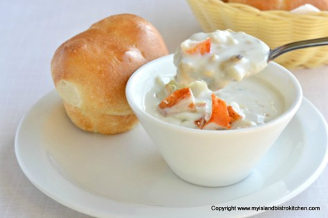 Bowl of seafood chowder and homemade roll at New Glasgow Lobster Suppers