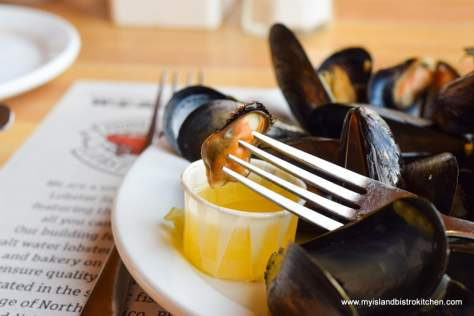 Steamed PEI mussels dipped in melted butter