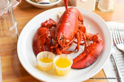 Lobster in the shell served with melted butter at Fisherman's Wharf Lobster Suppers