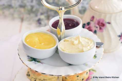 Dishes of Strawberry Jam, Lemon Curd, and English Double Cream for Scones