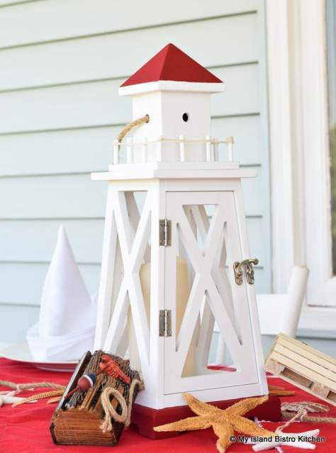 Red and White Lighthouse-shaped Wooden Lantern