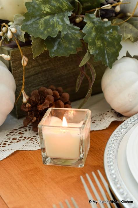 Votives add lovely glow from a low angle of a tablescape