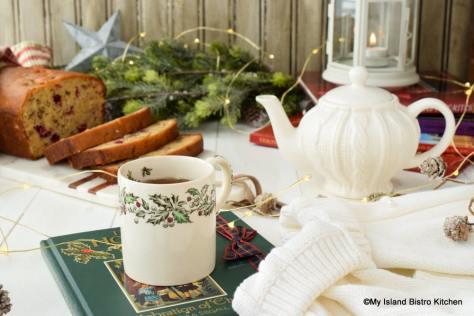 Antique Christmas Mug filled with tea to enjoy with Cranberry Orange Eggnog Loaf