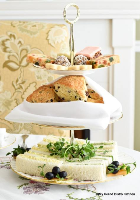 Three-tier server with sandwiches, scones, and sweets