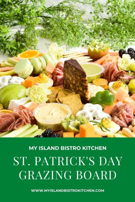 A grazing board filled with green, orange, and white foods for St. Patrick's Day