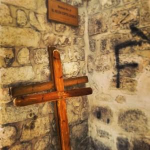 Crosses left by pilgrims at station nine on the Via Dolorosa