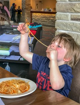 Happy child dining from the kids menu at the Fairmont Jasper Park Lodge
