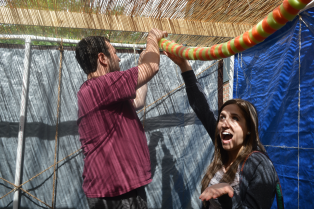 Jacob Gussin and Chelsea Rosenbaum help decorate the sukkah at Jewish Family Service.
