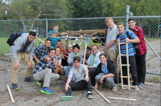 Students at Akiva High School participating in the School Sukkah Building Contest.