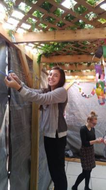 Students at Frankel Jewish Academy decorate their school's sukkah.