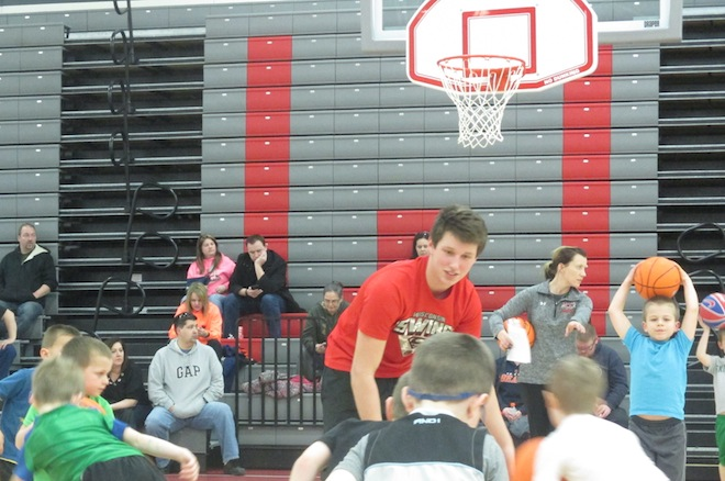 Kevin Brenner, a Panthers' basketball player, was one of about a dozen student-athletes that volunteered their time at Wilmot Union High School's first annual Mighty Mite camp last week (Photo by Jason Arndt).