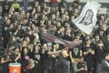 The Westosha Central student section proudly waves the school flag following the Falcon boys victory.