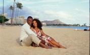 Couple enjoying their honeymoon on a fine white sand beach