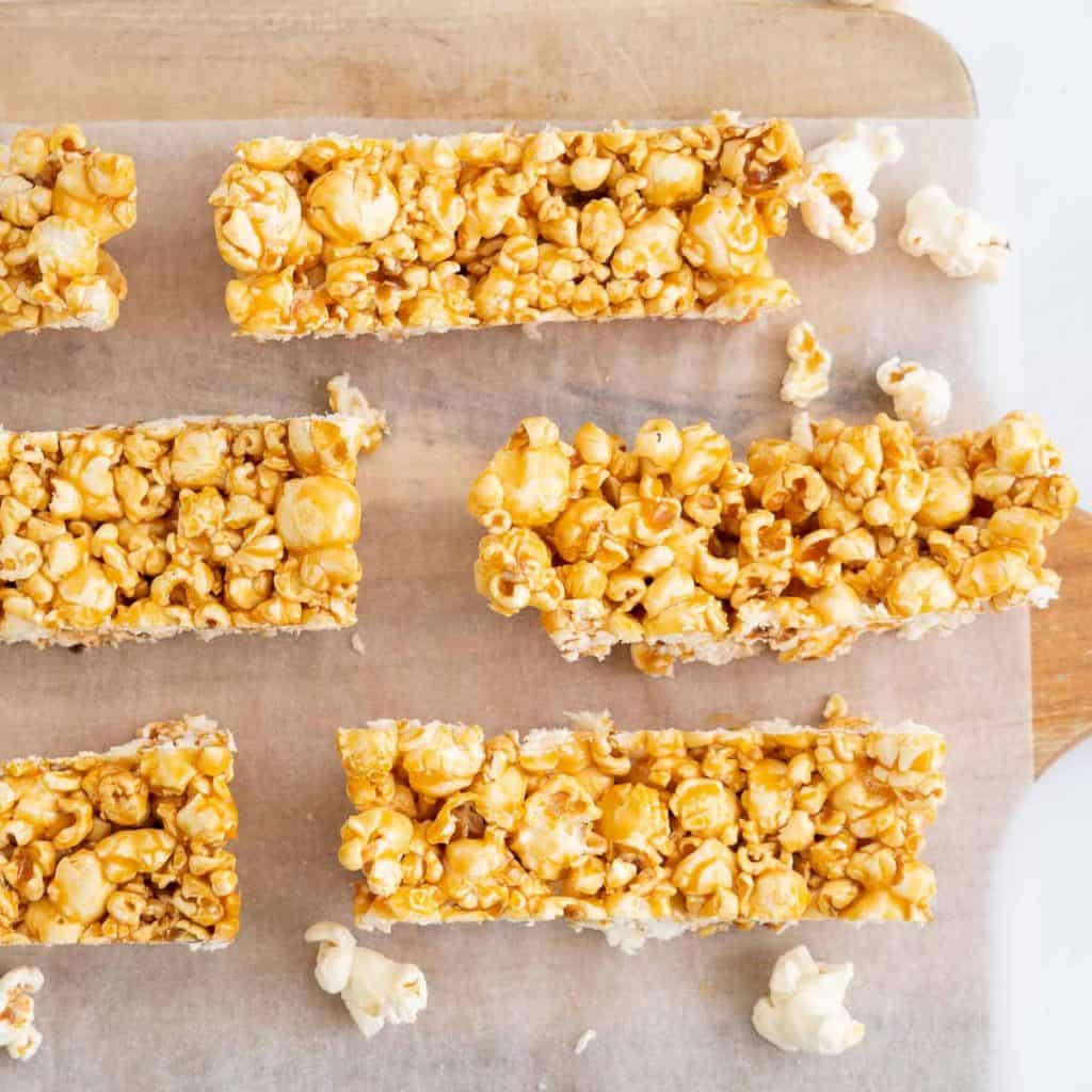 Popcorn bars on a wooden chopping board.
